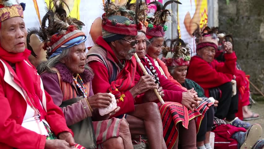 BANAUE - JANUARY 24 : Unknown old ifugao people in national dress next to rice terraces on Jan 24, 2014 in Banaue, Philippines. Ifugao - the people in the Philippines. Refers to the mountain peoples.