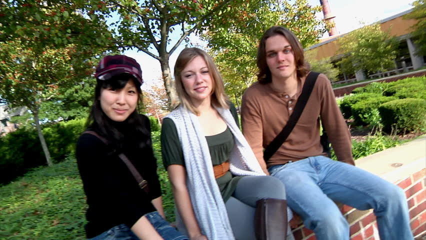Confident college students smile at the camera. - HD stock video clip