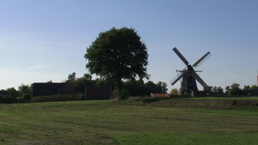 skyline Dutch countryside + windmill. WINTERSWIJK, THE NETHERLANDS - HD stock footage clip