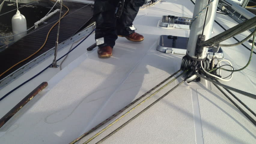 Yacht fibre glass gelcoat decks being power washed