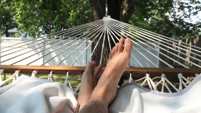 Man Resting in Hammock with His Feet Showing - HD stock footage clip