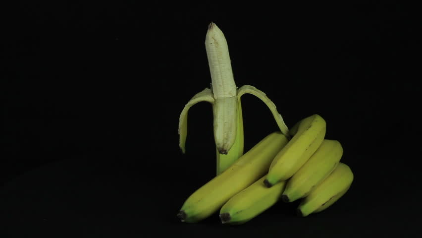 Bunch of bananas rotates on a black background - HD stock footage clip