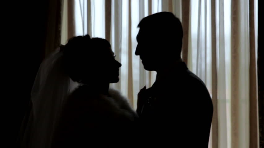 Silhouettes Of The Bride And Groom On The Background Of A ...
