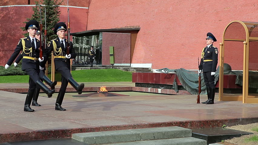 MOSCOW, RUSSIA - CIRCA APRIL, 2012: Soldiers march after passing the post at the Eternal Flame, the Kremlin, Moscow. - HD stock video clip