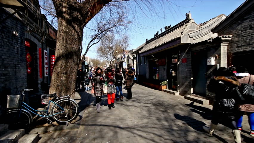 Beijing,China-Feb 20,2014: Walking along the famous Nanluogu alley during weekend in Beijing, China