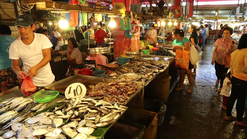 LOS BANOS, PHILIPPINES - JANUARY 18 - Customers shop for fresh seafood at an indoor market on January 18, 2014.