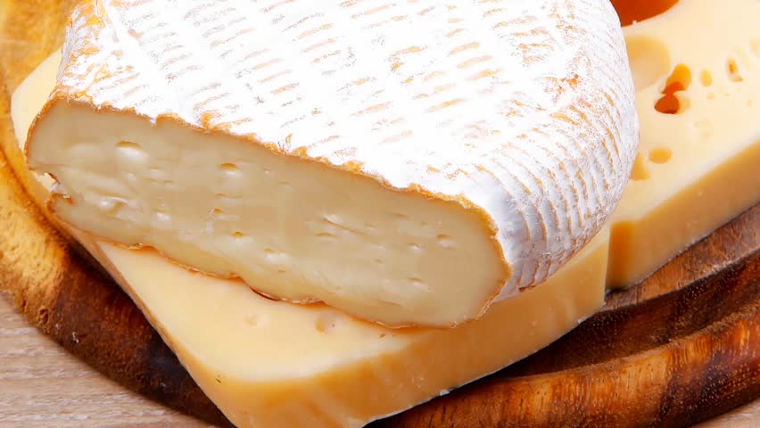 edam parmesan and brie cheese on wooden platter over wooden table 1920x1080 intro motion slow hidef hd