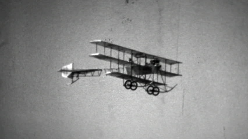 Digital copy of an old black and white film of a flying Avro 1910 replica triplane aircraft.