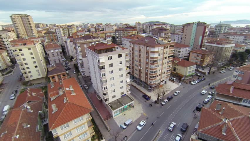 Aerial view from low flying camera of suburban neighborhood street and residential blocks. Residential housing community in Maltepe, Istanbul