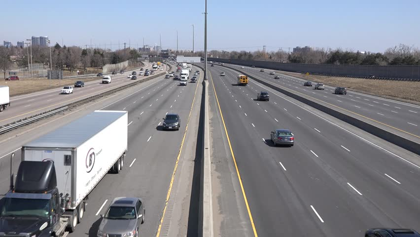 TORONTO,CANADA-APRIL3,2014: King's Highway 401. The segment of Highway 401 passing Toronto is the busiest highway in North America, and one of the widest and busiest in the world. - 4K stock video clip