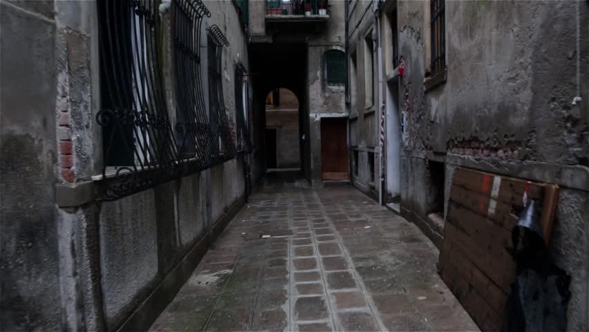 Dark alley of the rainy streets in Venice, Italy