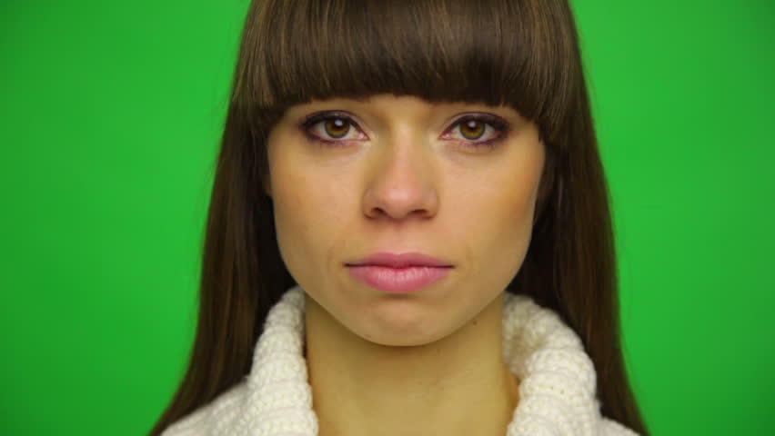 Upset woman cry covering her face by hand, young girl depression, stress and problems, pain, female depressed over green chroma key screen background