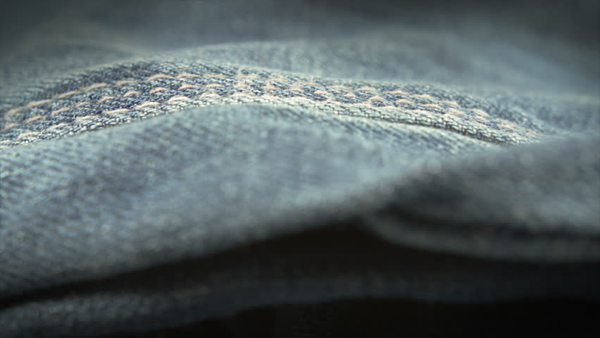 Blue denim jeans close up UHD stock footage. A close up dolly shot of blue denim material filmed on the Arri Alexa in Ultra high definition 3840 x 2160.
