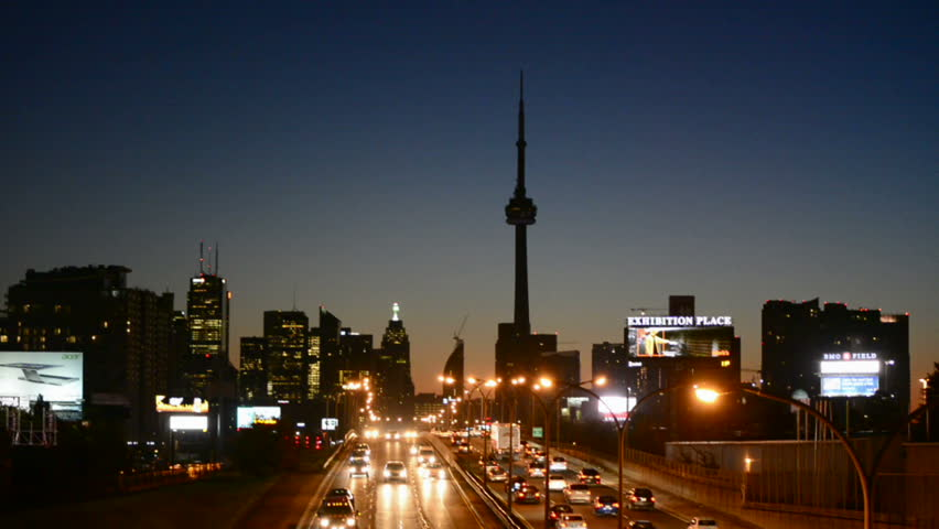TORONTO,CANADA-APRIL 9, 2014: CN Tower at dawn as seen from the Gardiner Exprssway. One of the tallest free standing structure in the world and one of highest bulidings. A tourist landmark