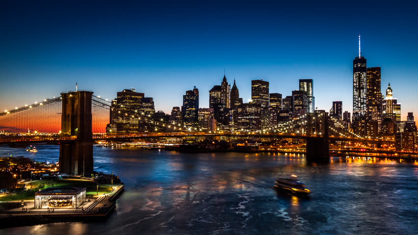 Timelapse with Brooklyn Bridge and Lower Manhattan going through sunset, dusk and night.