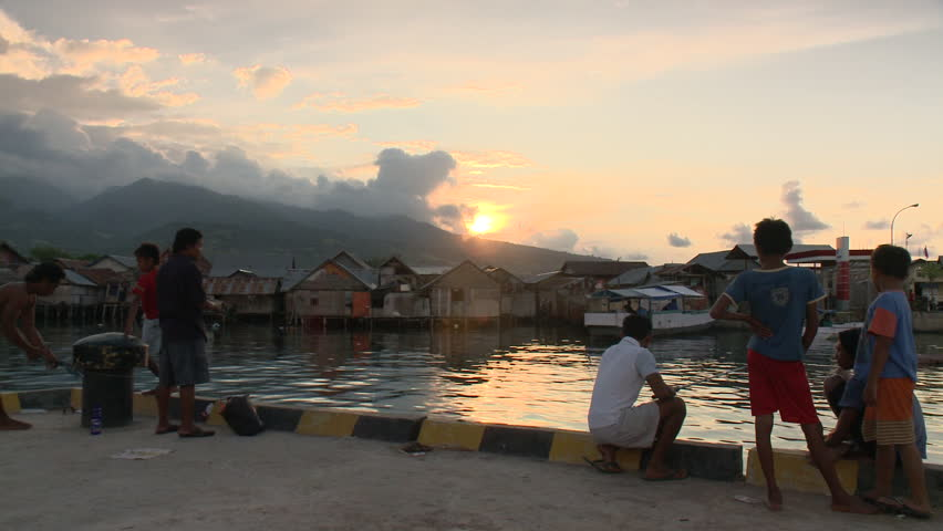 INDONESIA - CIRCA 2011 - Fishing off a village pier at sunset circa 2011 in Indonesia. - HD stock video clip