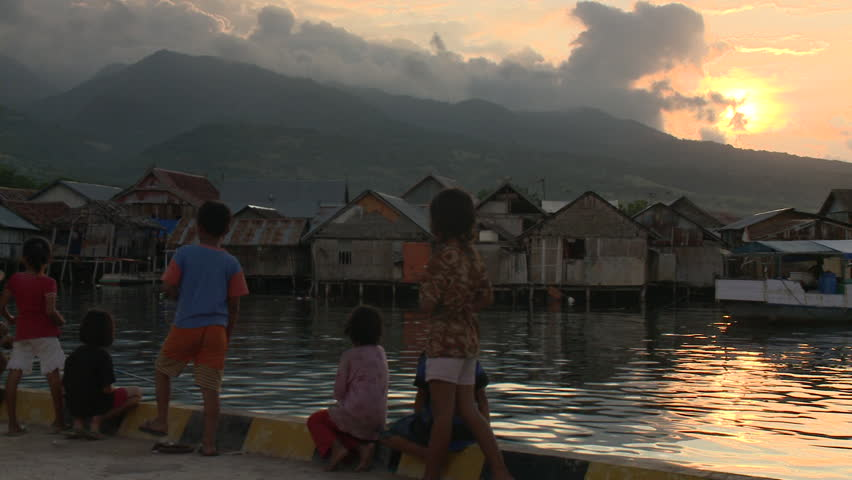 INDONESIA - CIRCA 2011 - Children in a village at the waterfront circa 2011 in Indonesia. - HD stock video clip