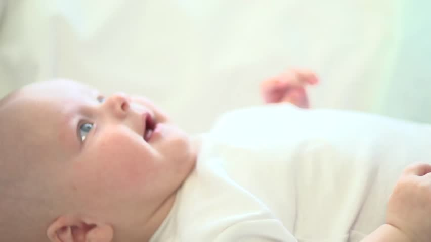Newborn baby smiling. Close-up. Healthy Adorable Infant Laughing. Slow motion Video Footage full hd 1080. High speed camera 240 fps