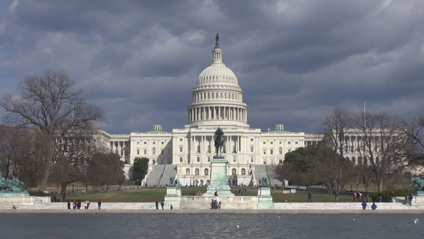 Capitol Congress building and pool reflection with stormy cloud, hurricane in Washington DC by day - HD stock video clip