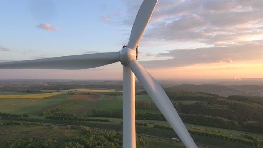 Wind turbines producing clean renewable energy - HD stock footage clip