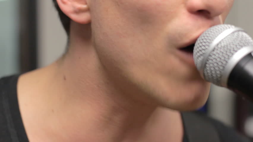 Close-up of a singer's mouth while he sings - HD stock video clip