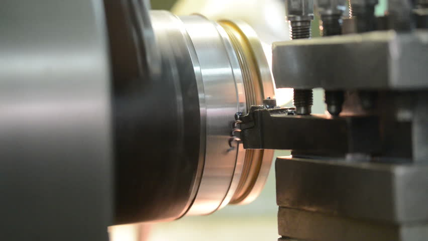 industrial metal work machining process of shaft by cutting tool on lathe - HD stock footage clip