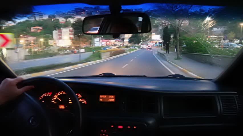 Driving car on a busy city street. POV from interior of car as it drives through city streets.