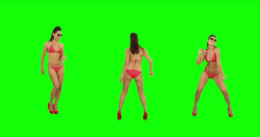 Beautiful young girl in bikini dancing against green screen. Just like beach party! - 4K stock footage clip