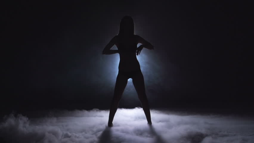 Silhouette of unrecognizable lady dancing in slow motion