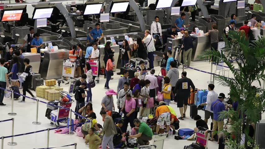 BANGKOK, THAILAND - APRIL 27, 2014 : Unidentified passengers arrive at check-in counters at Suvarnabhumi Airport . The airport handles 45 million passengers annually.