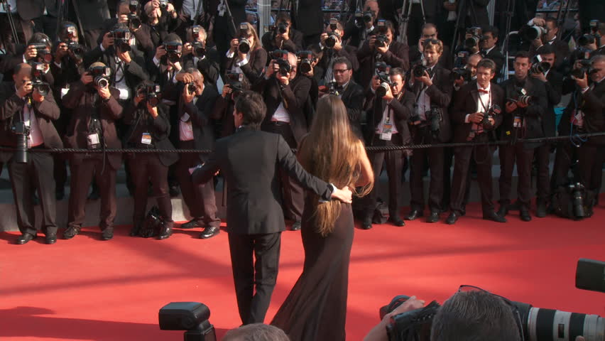 CANNES, FRANCE - MAY 2014: Adrien Brody and Lara Lieto on the red carpet for the closing ceremony at the 67th Cannes Film Festival.