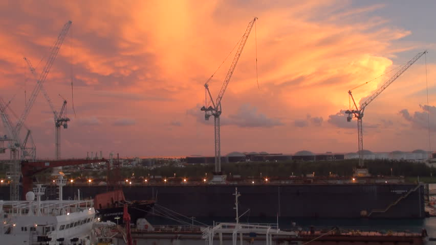 Bahamas - Freeport - Industrial Port -Container Terminal And Ship In Dry Dock At Sunset- High Definition - Time Lapse / Bahamas - Freeport - Industrial Port -  Ship In Dry Dock