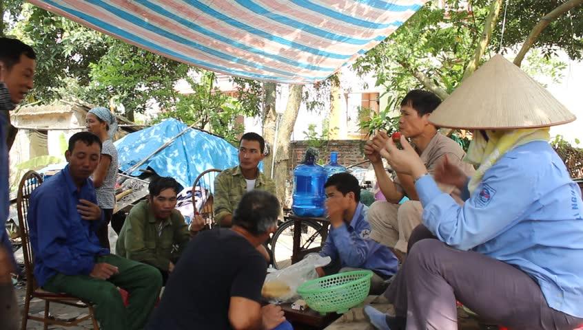 HAI DUONG, VIETNAM, May, 20: Workers take a break after working hours on May, 20, 2014 in Hai Duong, Vietnam