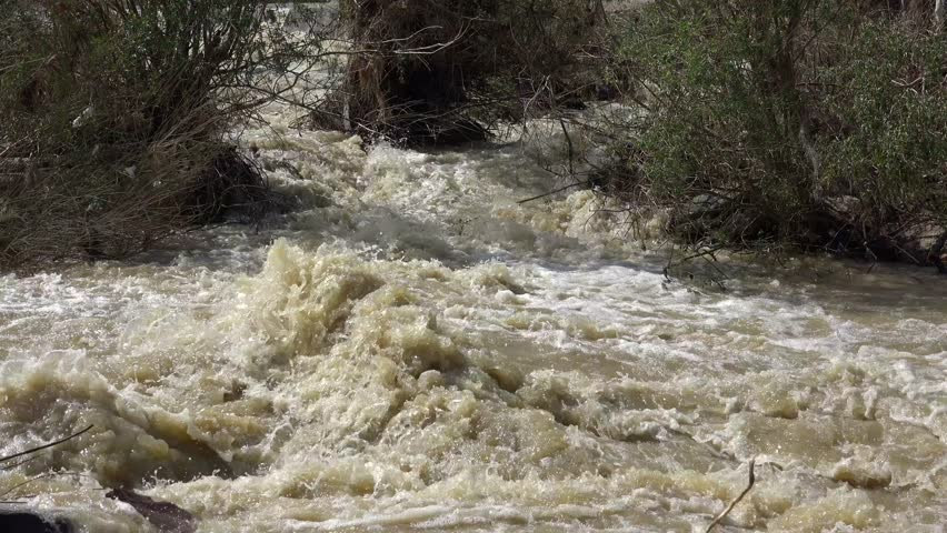 Ultra HD 4K Mountain Muddy River in Flood, Flooding by Rain, Storm, Flooded, Calamity - 4K stock footage clip