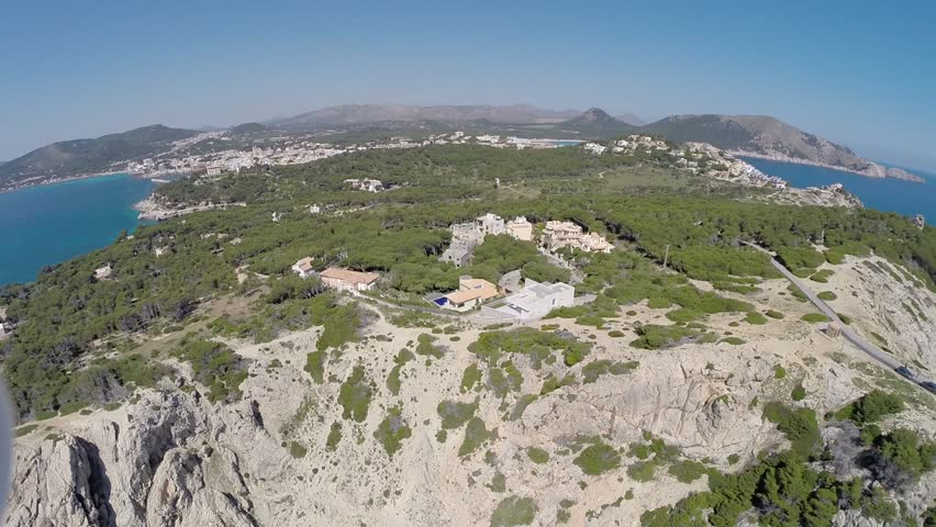 Cala Rajada Coastline with Lighthouse - Aerial Flight, Mallorca - HD stock footage clip