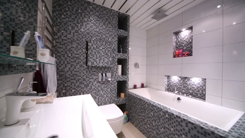 Full bathroom with bath, washbasin and toilet bowl.