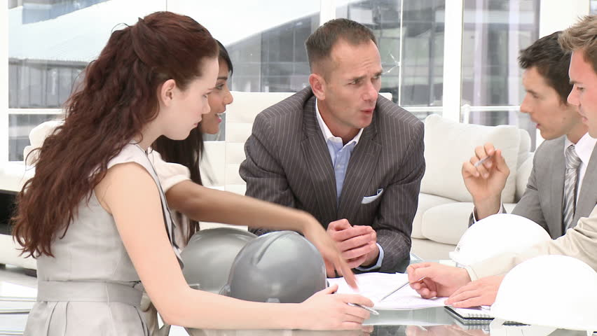 A group of architect studying a construction plan in a meeting - HD stock video clip