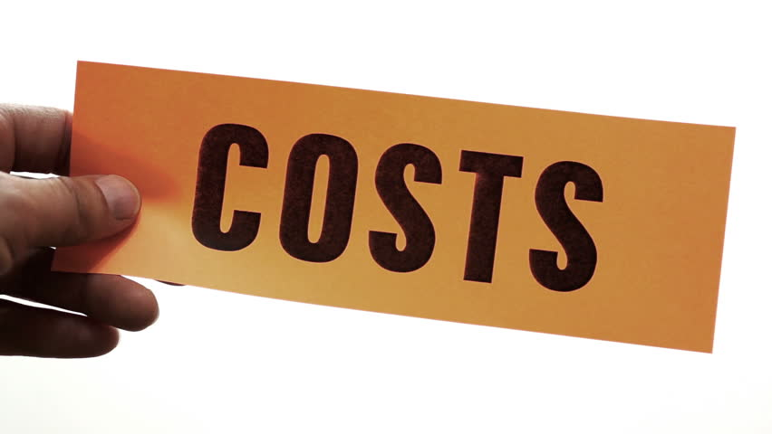 Cutting a bright orange piece of paper with the word costs printed on it as a cost cutting concept business or personal.