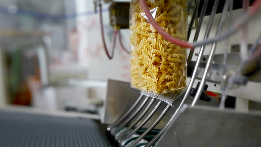 Raw fusilli envelopes in a pasta factory.