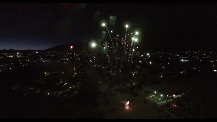 Spectacular aerial video of a fireworks show in a suburban setting.