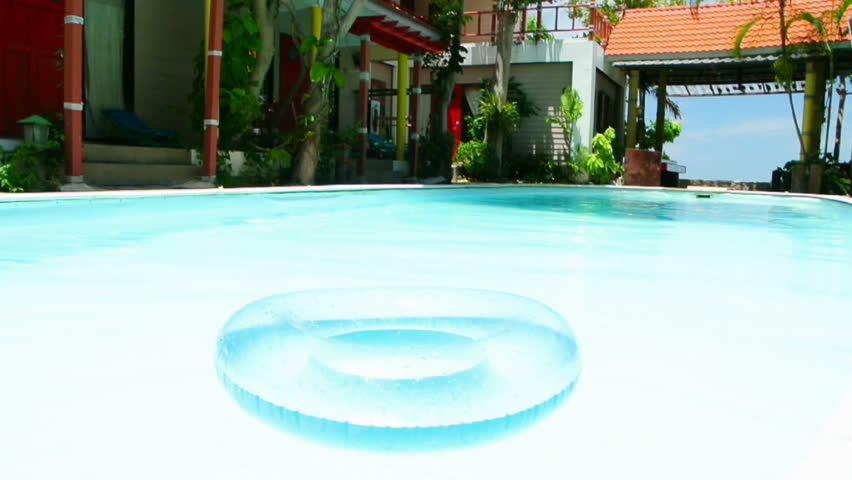 Blue inner tube floating in a swimming pool full hd - Get a swimming pool full of liquor ...