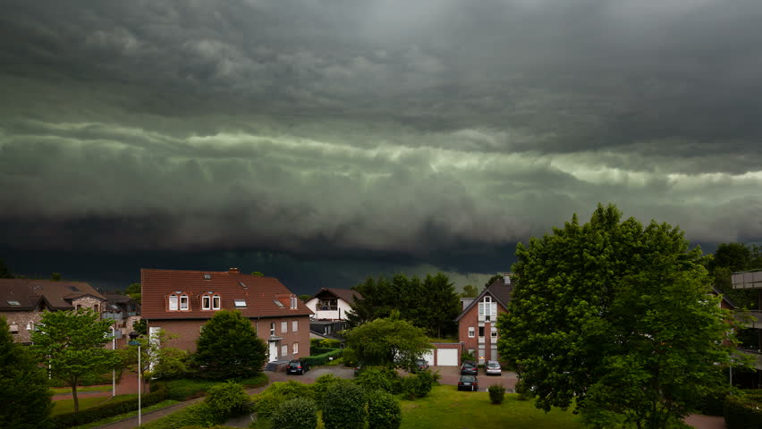 Timelapse zooming in of a spectacular cloud front of a thunderstorm turning day into night. The thunderstorm was one of the worst of the last decade in the west of Germany and caused heavy damage.