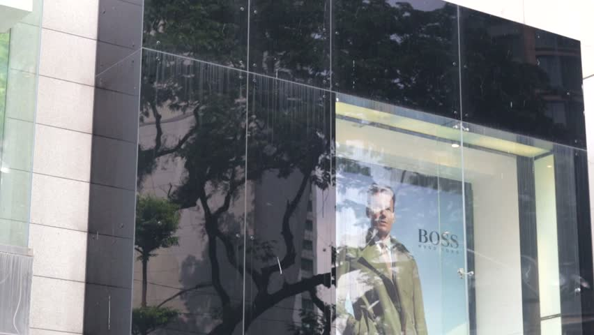 KUALA LUMPUR, MALAYSIA - CIRCA JUNE 2014: Hugo Boss store. Hugo Boss is a German luxury fashion and style house based in Metzingen, Germany. It is named after its founder, Hugo Boss (1885-1948).