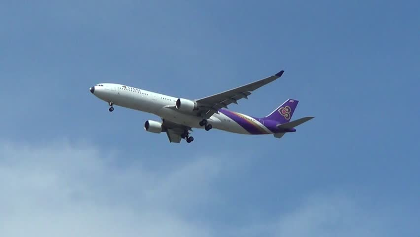 CHIANGMAI , THAILAND - MAY 2 2014: HS-TEM Airbus A330-300 of Thaiairway. Landing to Chiangmai airport from Bangkok Suvarnabhumi.