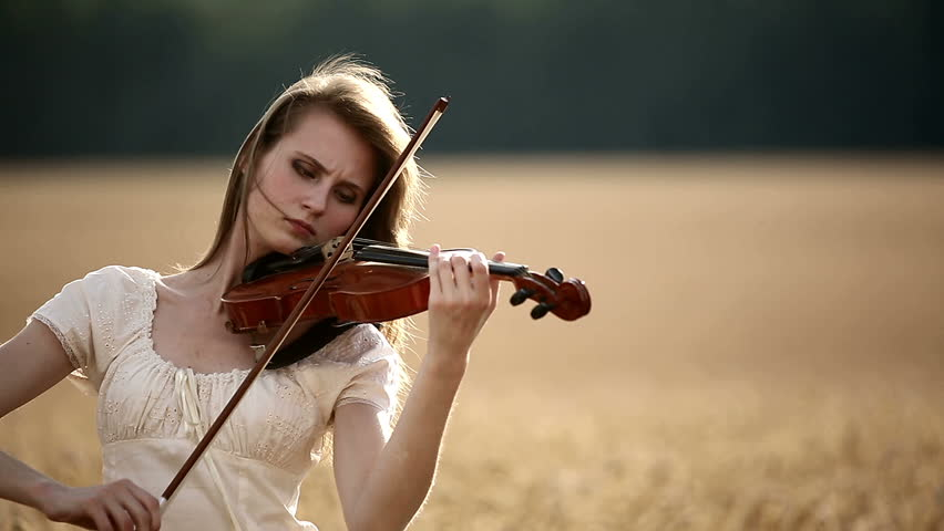 Girl Violinist Playing The Violin In Wheat Field. Close Up ...