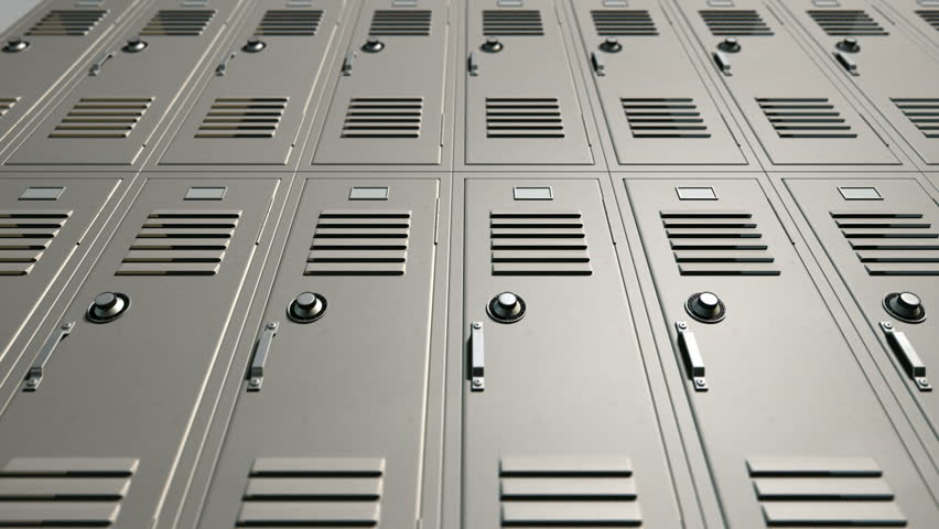 A slow low angle pan view of a stack of metal school lockers with combination locks and doors shut