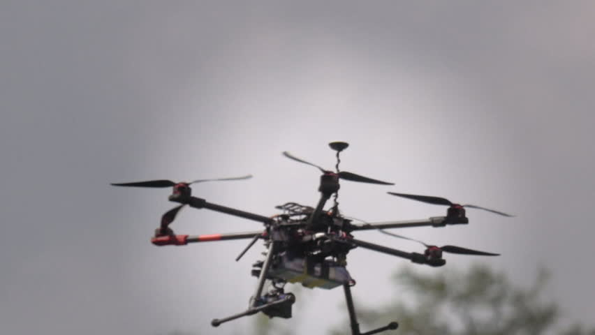 Professional drone flying with GPS making a ride over the forest