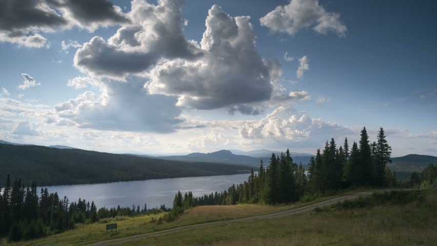 spectacular mountain landscape, Gålåvannet lake, Norway, summer, Summer afternoon at lake Gålåvann, Gålå, Norwegian mountains, view towards Jotunheimen. Site of Peer Gynt play (Ibsen). Sheep grazing.