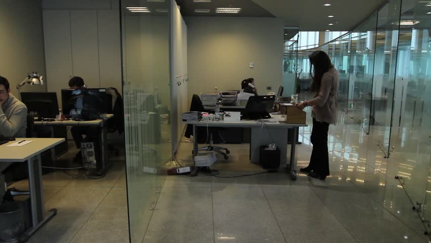 SANTIAGO, CHILE - OFFICE - People work in different areas in large and busy office.