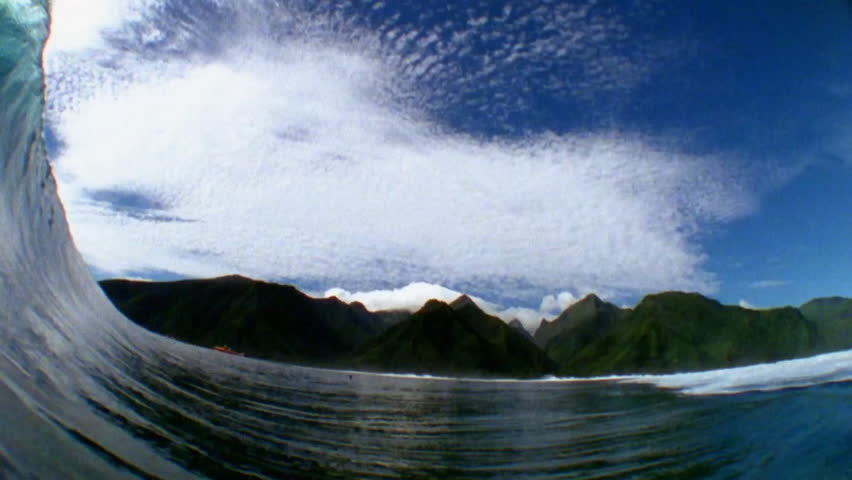 POV shot of a wave rolling and breaking into sea